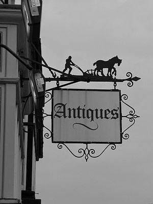 Antiques shop sign in Tring, Hertfordshire.