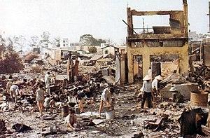 Civilians sort through the ruins of their home...