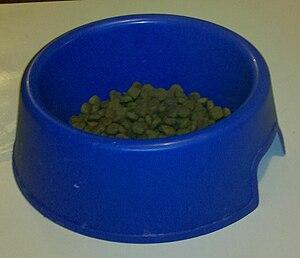 English: Large blue dog food bowl, half full o...