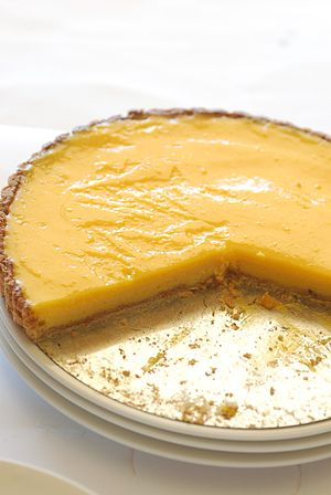 Lemon curd tart with crumbs.