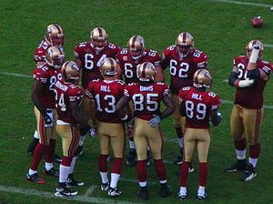 The San Francisco 49ers in a huddle during a r...