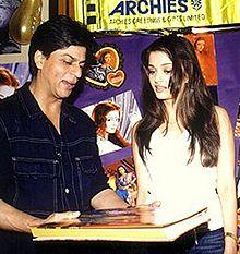 Shah Rukh Khan views a book with Aishwarya Rai in 2002