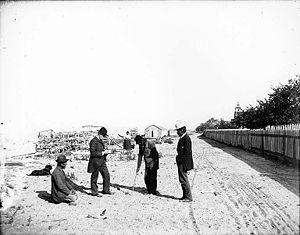 Klallam men in western clothes on beach Clalla...