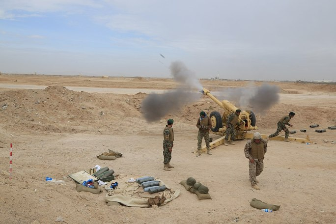Afghan National Army soldiers fire a 122mm Howitzer 2A18 (D-30) 140312-M-EN264-082