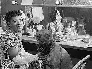 Billie Holiday and her dog Mister, probably Do...