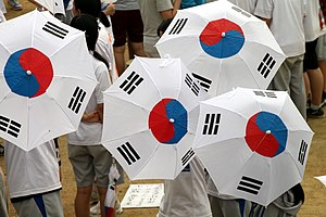 English: Students don Korean Flag Umbrellas to...