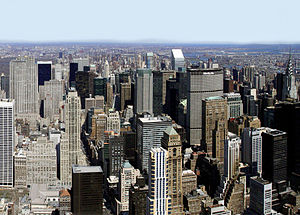 The island of Manhattan, from which the term i...