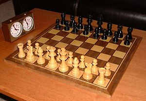 Chess game and play clock with the pieces in t...
