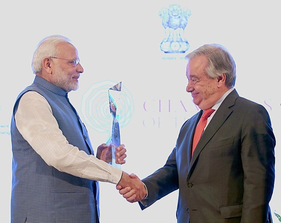 """File:The Prime Minister, Shri Narendra Modi being presented the """"Champions of The Earth"""" award by the Secretary General of the United Nations, Mr. Antonio Guterres, at a function, in New Delhi on October 03, 2018.JPG"""