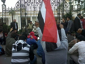 Demonstrators and army outside the Egyptian pa...