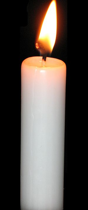 a candle, black background