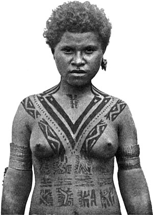 English: A marriageable girl. Tattooing of a K...