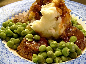 Faggots, gravy, mashed potatoes and marrofat peas.