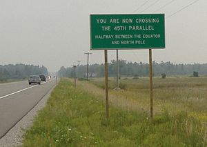 English: 45th Parallel marker along highway US...