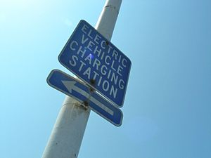 A sign pointing the direction to an Electric C...
