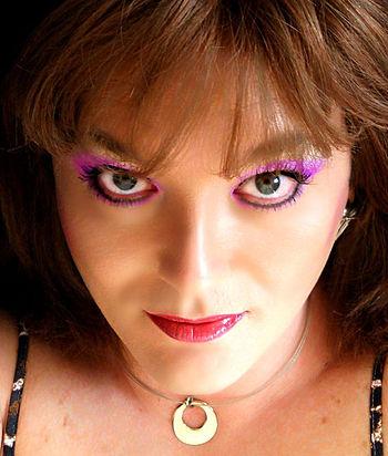 English: Close-up of face wearing makeup.