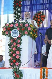 Modi speaking at flower-decked podium