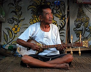 A teacher of traditional music at his house in...