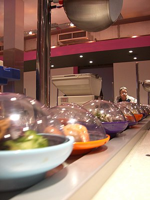 Yo! Sushi containers on the conveyor belt