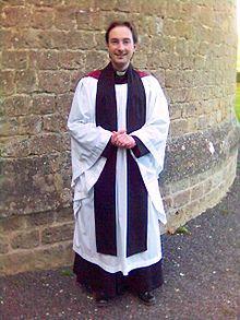 Anglican priest in choir habit. Photo taken by Gareth Hughes, 2005.