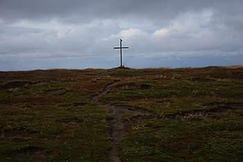 English: A cross close to the church in Grense...
