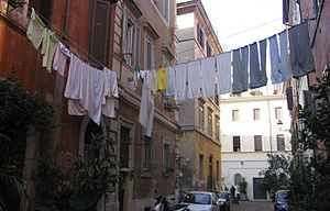 Laundry is hung to dry above an Italian street.