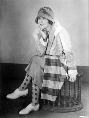 Photograph of Norma Shearer sitting