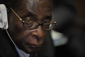 Robert Mugabe, the president of Zimbabwe, atte...