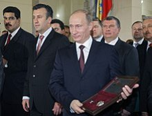 Maduro, beside Tareck El Aissami, present Vladimir Putin the Key to the City of Caracas in April 2010.