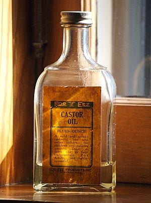 A bottle of castor oil sitting on the window s...