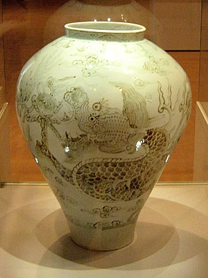 Joseon white porcelain with cloud and dragon p...