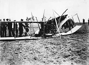 Men inspecting wreckage of first Toronto airpl...
