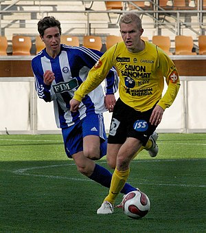 Striker Ilja Venäläinen (#10, in yellow) of Ku...