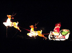 English: Santa and his reindeer flying past Ro...