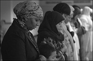 """Women pray during Friday noonday prayer ..."