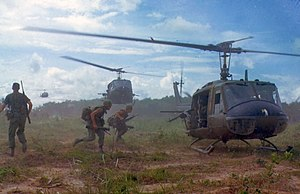 U.S. Army Bell UH-1D helicopters airlift membe...