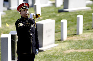 "A bugler plays ""Taps"" during the fun..."