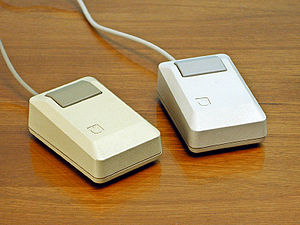 Apple Macintosh Plus mice (left) Beige mouse (...