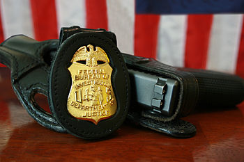 FBI Badge & gun.
