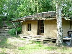 Lehmverputztes Strohballenhaus