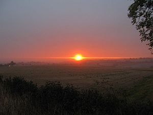 English: Sunrise over the gap A view of the su...