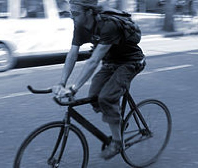 Cyclist Riding A Fixed Gear Bike Without Brakes