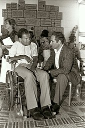 Netanyahu (right) with Sorin Hershko, a soldier wounded and permanently paralyzed in Operation Entebbe, 2 July 1986