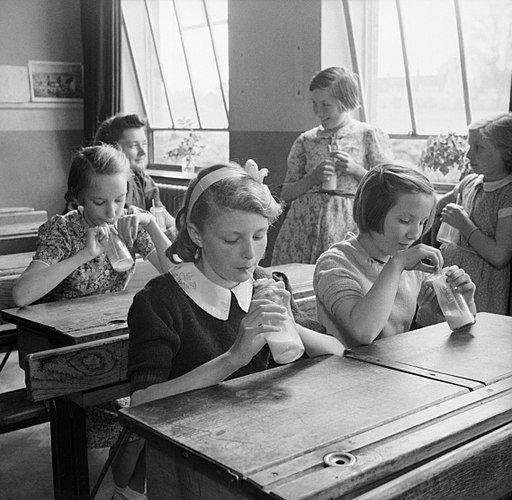 Girls at Baldock County Council School in Hertfordshire enjoy a drink of milk during a break in the school day in 1944. D20552
