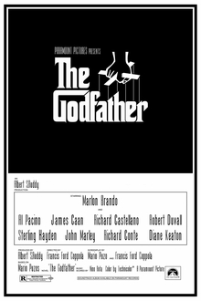 The Godfather written on a black background in stylized white lettering, above it a hand holds puppet strings.