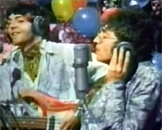 "Lennon (right) performing ""All You Need I..."