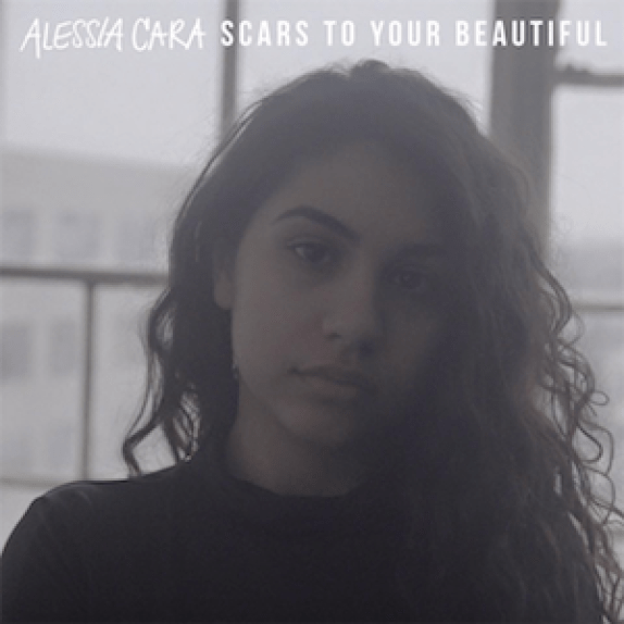 "Brown girl looking into camera with glare in background - ""Scars to your beautiful"" Alessia Cara - Song Cover"