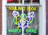 A neon sign commemorating Soulard Mardi Gras f...
