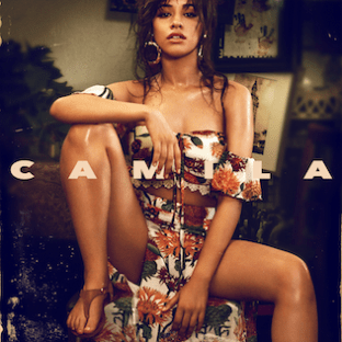 The cover image features Camila Cabello in foreground sitting on a small circular table wearing nature themed bra-like crop-top and long-skirt. In the background is a dim-lighted living-room. Above everything, in the middle, spread over whole width, in capitalised and bold format, is written the title 'CAMILA'.