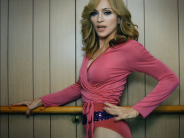 Madonna wearing a pink leotard while dancing i...